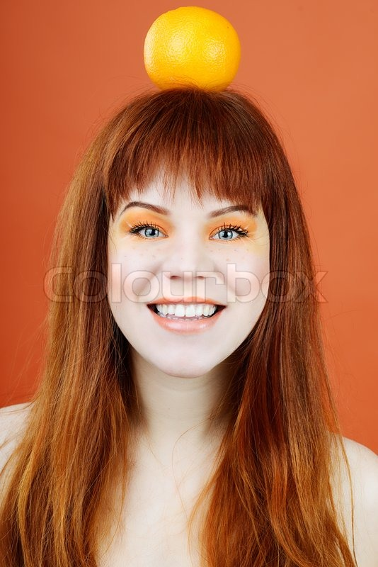 Stock image of 'Girl with orange'