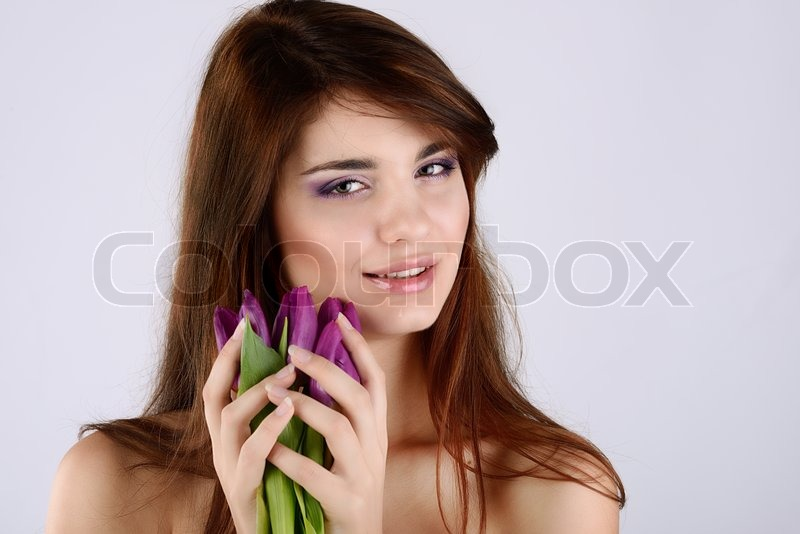Stock image of 'Tender girl with tulips'