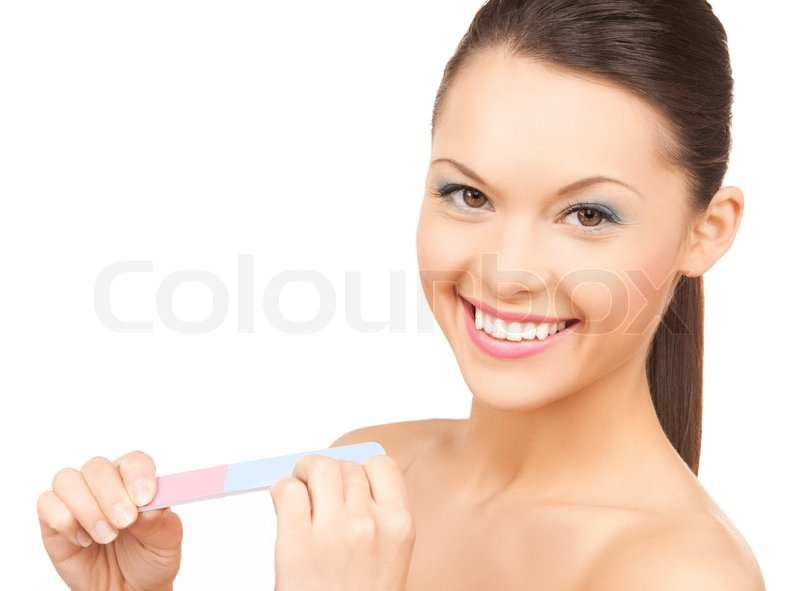 Stock image of 'Smiling young woman polishing her nails'
