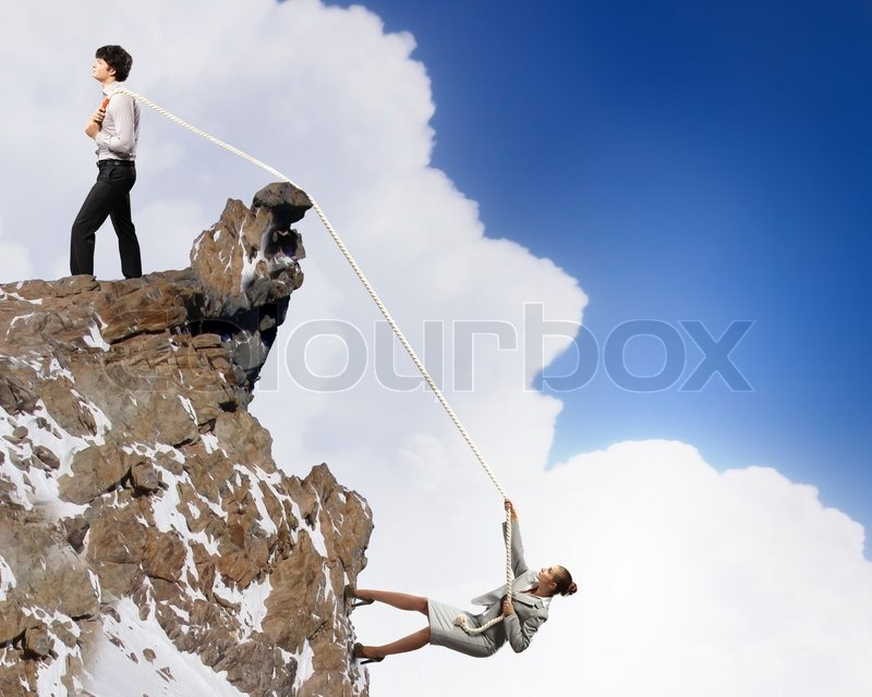 Stock image of 'Two businessmen pulling rope atop of mountain'