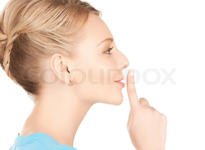 Stock image of 'Woman with finger on her lips'