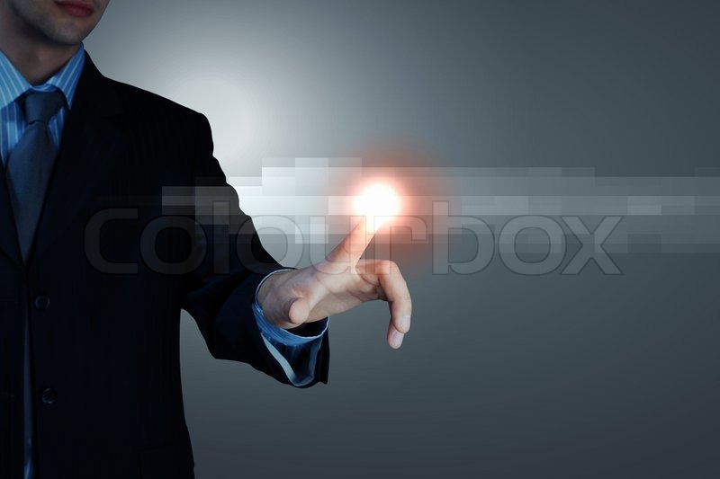 Stock image of 'Business man touching display'
