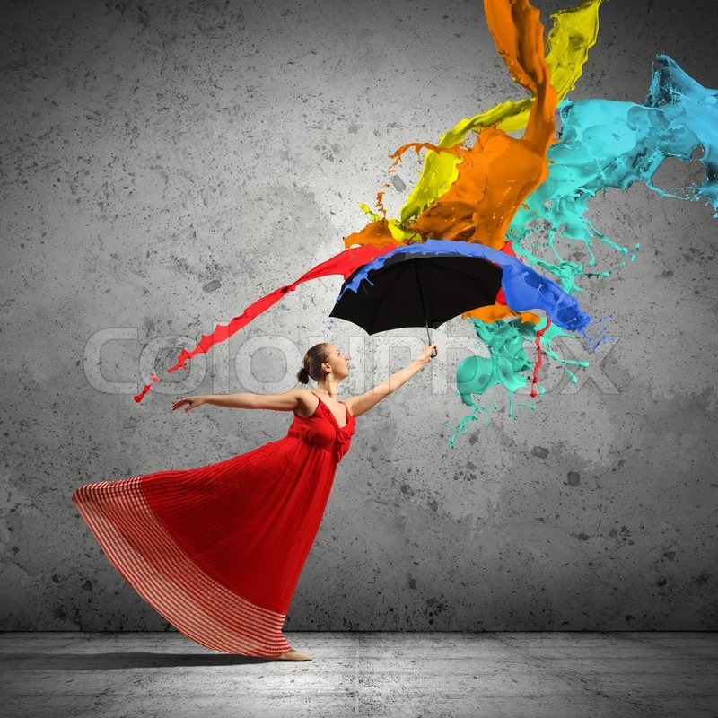 Stock image of 'ballet dancer in flying satin dress with umbrella under the paint'
