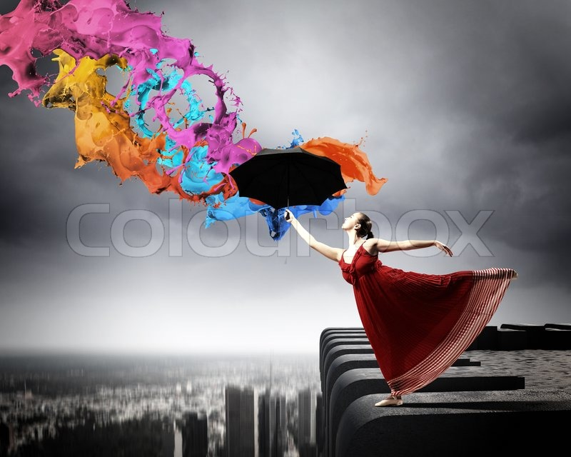 Stock image of 'Ballet dancer in flying satin dress with umbrella'