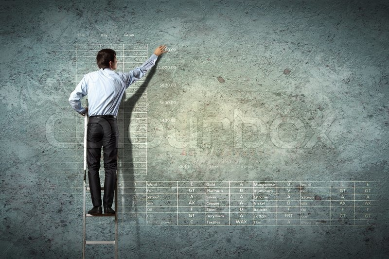 Stock image of 'Businessman drawing diagram'