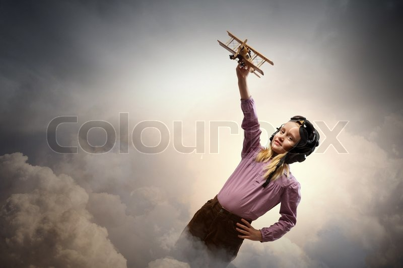Stock image of 'Little girl in pilot's hat'