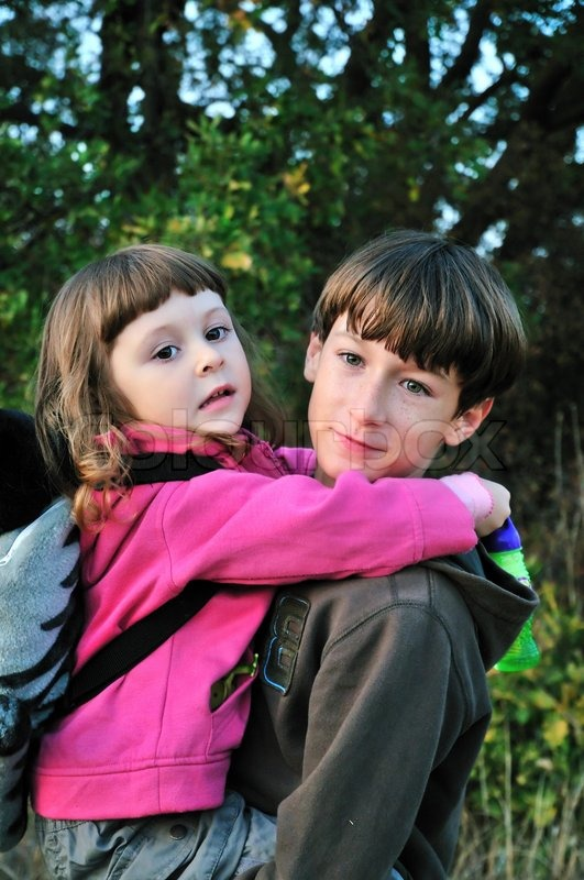 Stock image of 'Brother holding sister'
