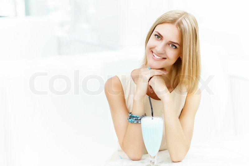 Stock image of 'Young woman with a glass of drink'