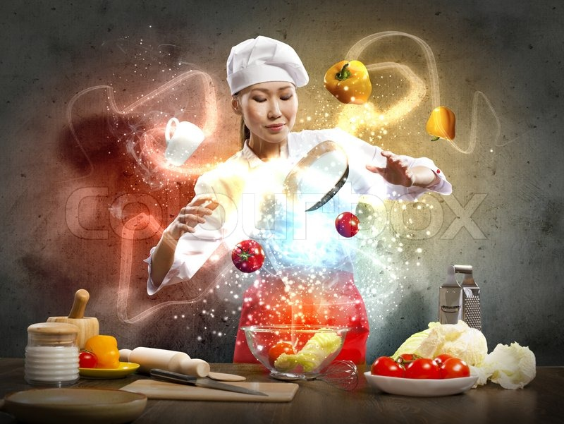 Stock image of 'Asian female cooking with magic'
