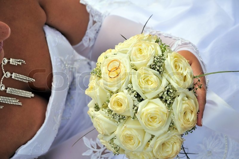 Stock image of 'Wedding flowerd and ring'