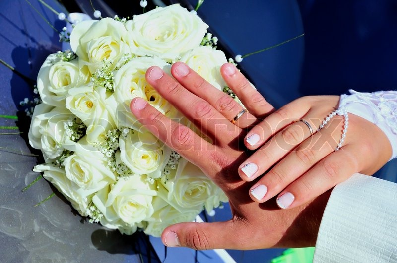 Stock image of 'Just married hands'