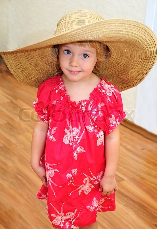Stock image of 'Funny girl wearing huge hat'
