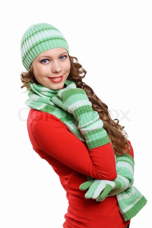 Stock image of 'Young woman wearing winter hat and warm scarf'
