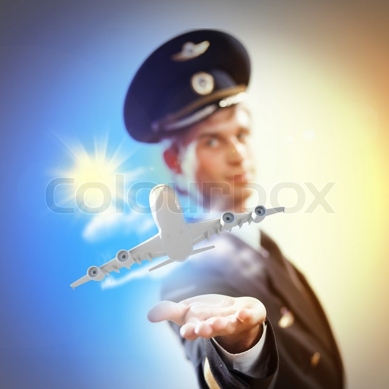 Stock image of 'Image of pilot with plane in hand'