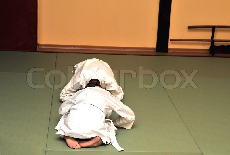 Stock image of 'bow of boys before the competition aikido'