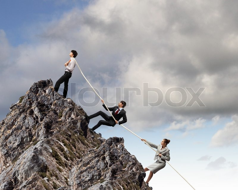 Stock image of 'Three business people pulling rope'