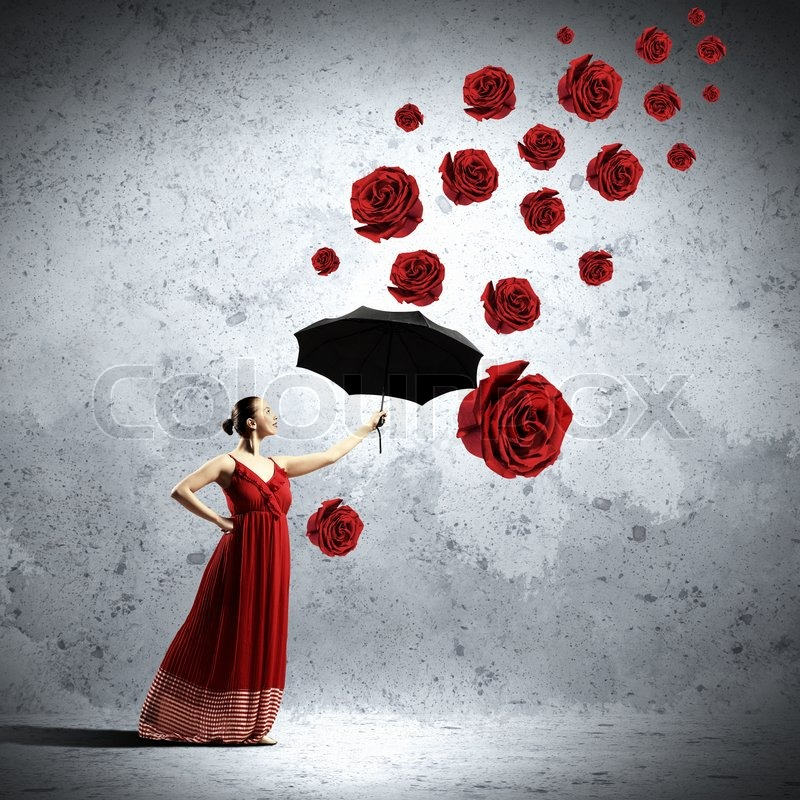 Stock image of 'ballet dancer in flying satin dress with umbrella and flowers'
