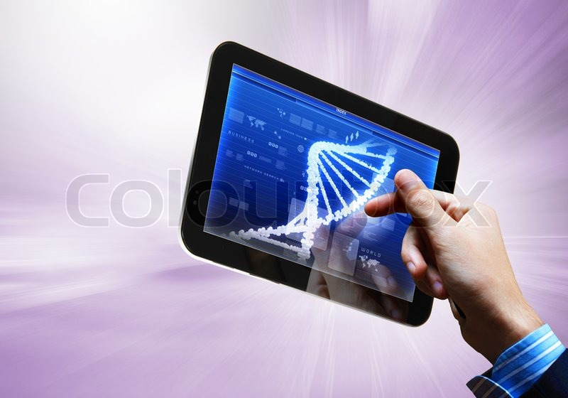 Stock image of 'Dna strand On The Tablet Screen'