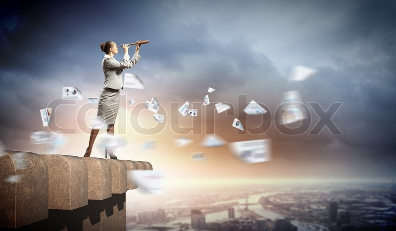 Stock image of 'Business woman with telescope'
