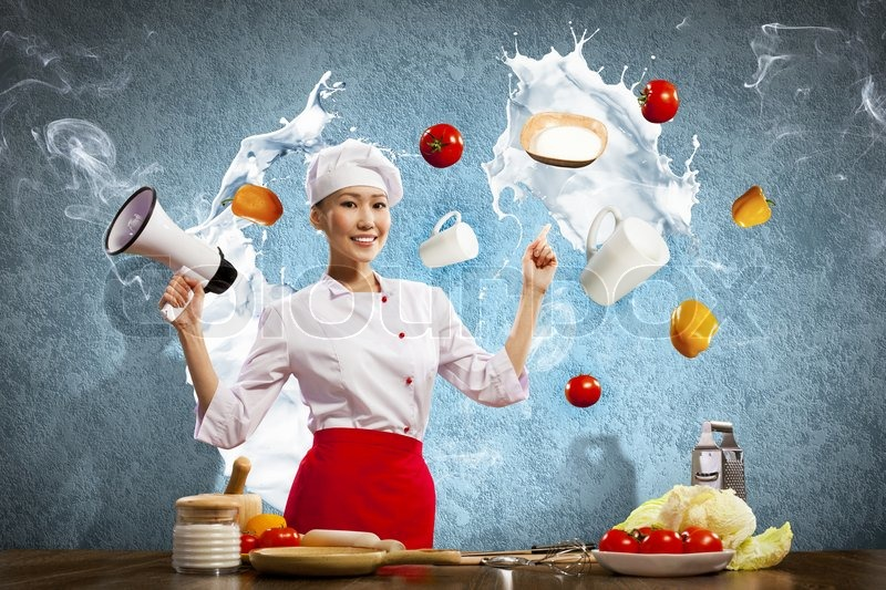 Stock image of 'Asian female cook holding megaphone'