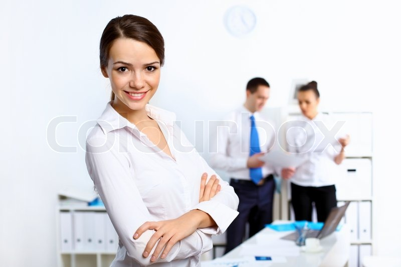 Stock image of 'Young businesswoman in the office'
