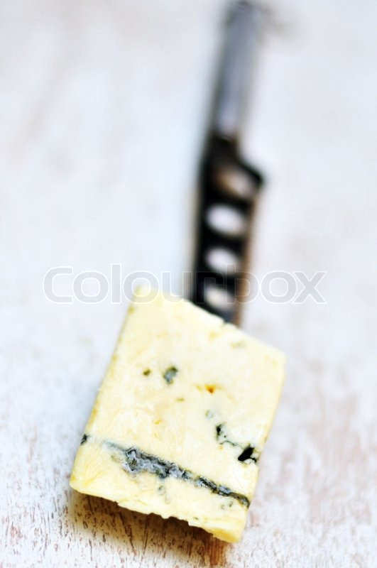 Stock image of 'Cheese on the knife'