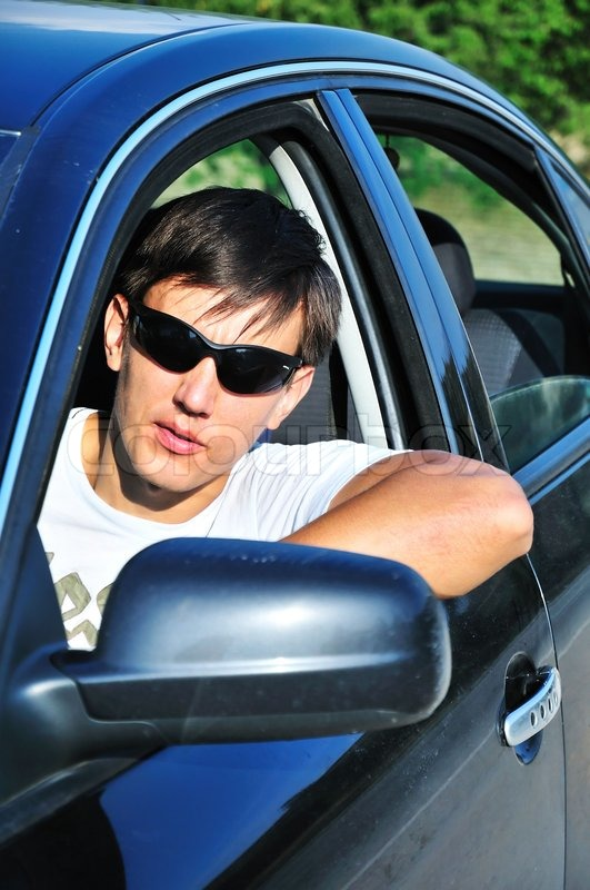 Stock image of 'Man in car'