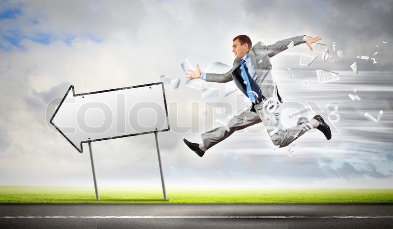 Stock image of 'Businessman running on the road'