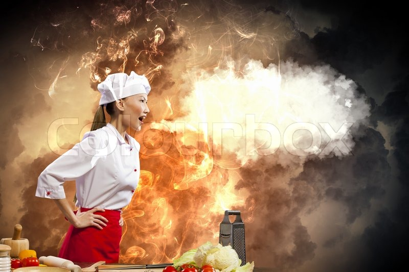 Stock image of 'Asian female cook in anger'