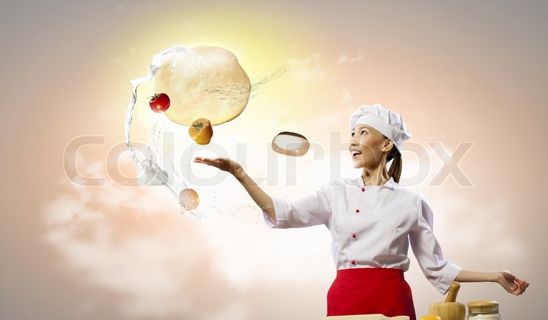 Stock image of 'Asian female cook making  pizza'