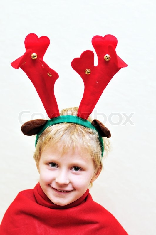 Stock image of 'Little boy with christmas antlers'