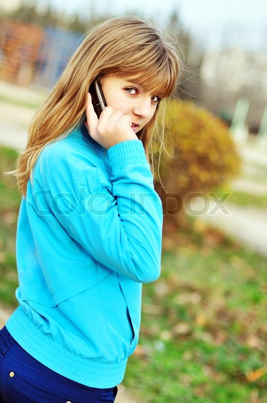 Stock image of 'Talking by phone'