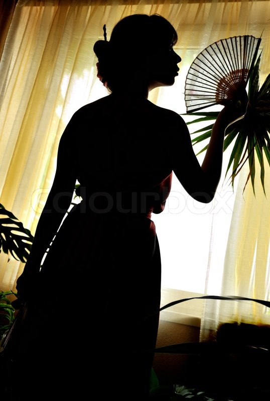 Stock image of 'Shadow-figure of oriental woman'