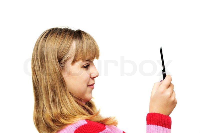 Stock image of 'Teenager girl looking on mobile phone'