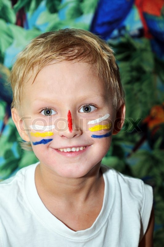 Stock image of 'boy painted on own face stripes, like Indian'