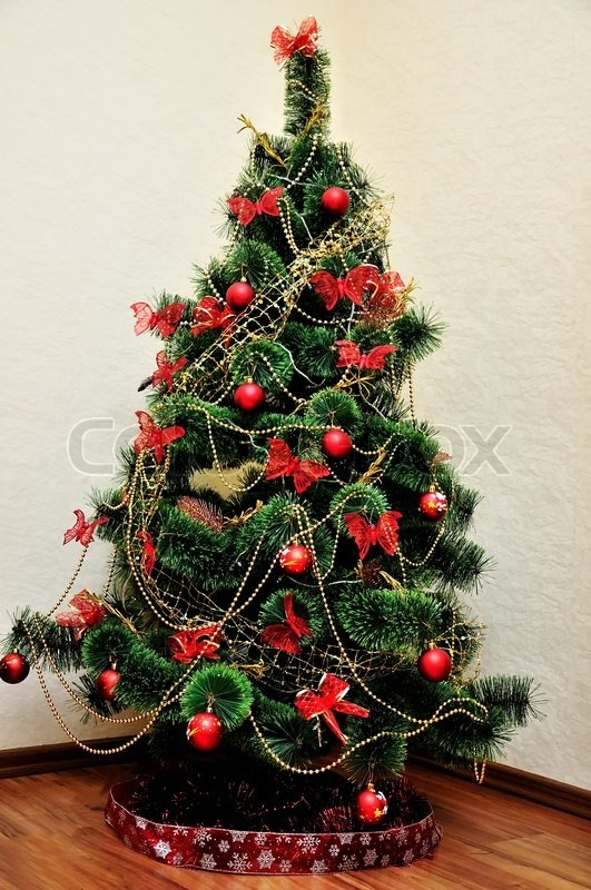 Stock image of 'beautiful Christmas Tree  in red and gold colors'