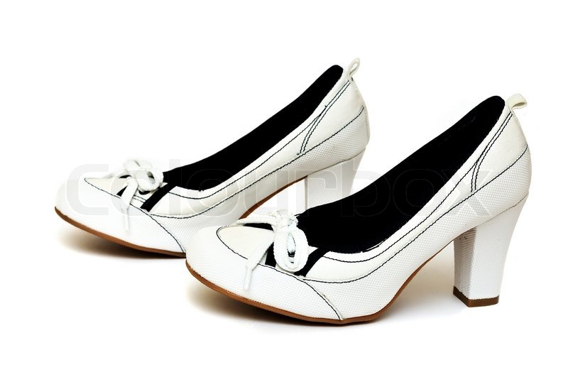 Stock image of 'White female shoes on a white background'