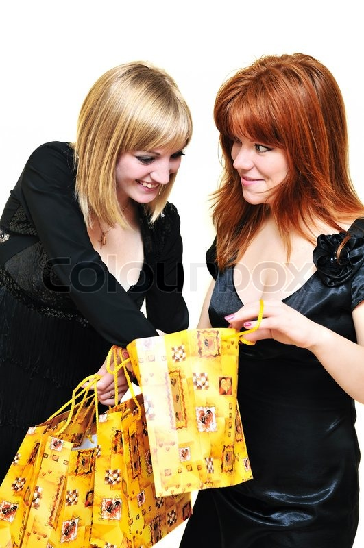 Stock image of 'Two curious shopping girls'