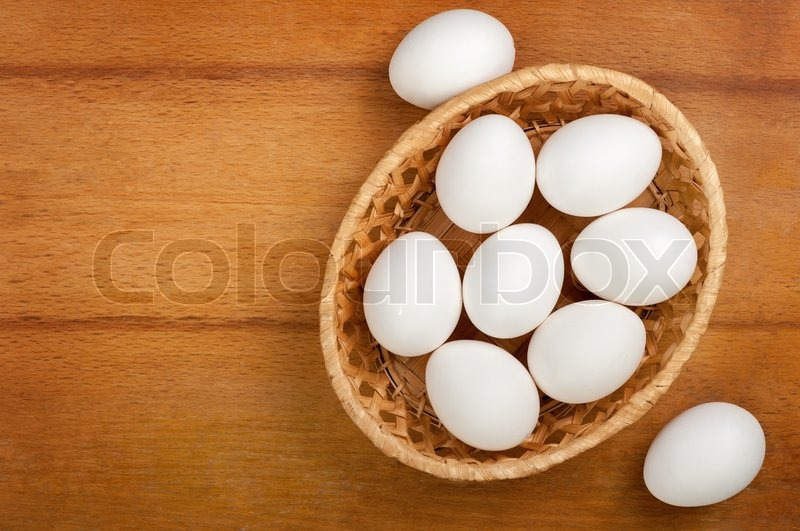 Stock image of 'Eggs in a wicker bowl'