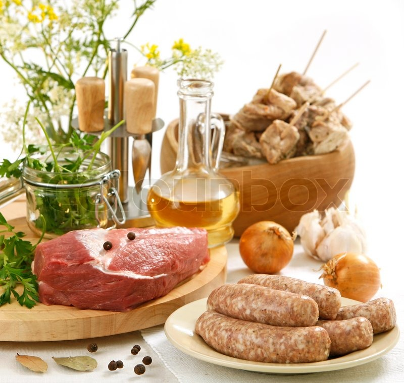 Stock image of 'Various raw meat and sausages'