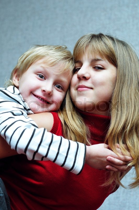 Stock image of 'Brothe hugging sister'