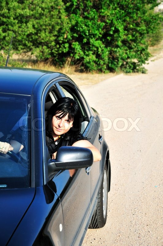 Stock image of 'Woman driving a car'