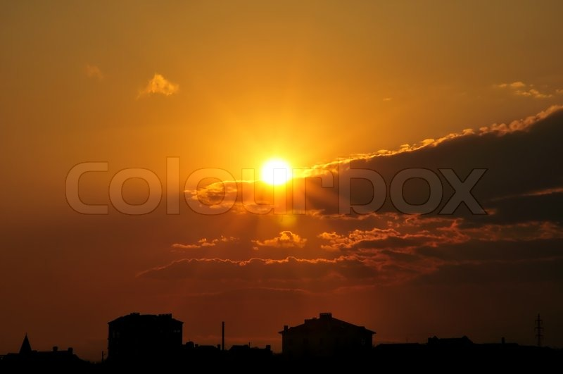 Stock image of 'Sunrise in little town'