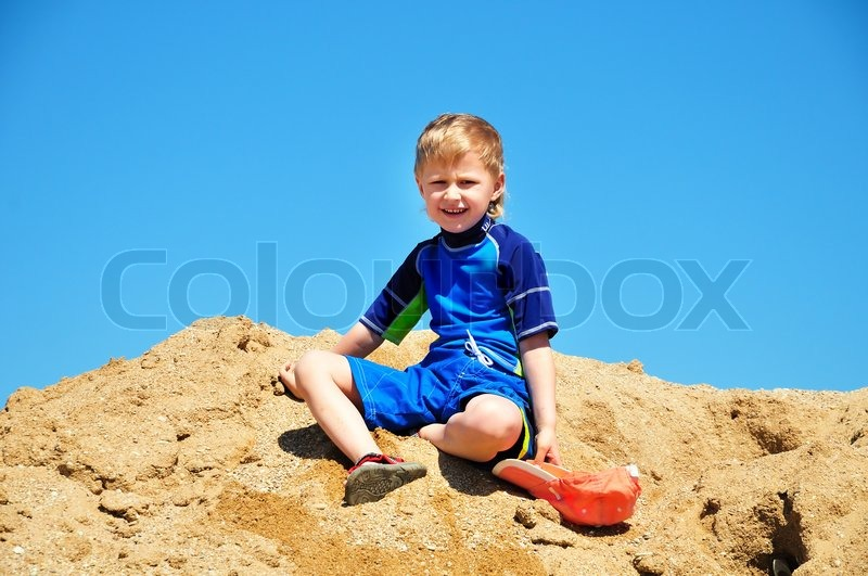Stock image of 'Boy in sand'