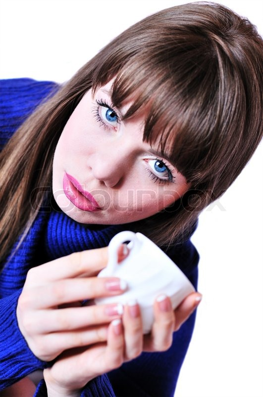 Stock image of 'Blue-eyed drinking girl wearing blue sweater'