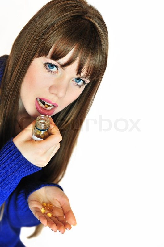 Stock image of 'Girl taking pills'
