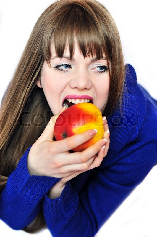 Stock image of 'Woman eating red apple'