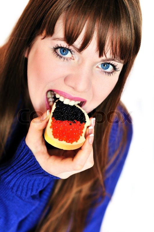 Stock image of 'Girl eating caviar'