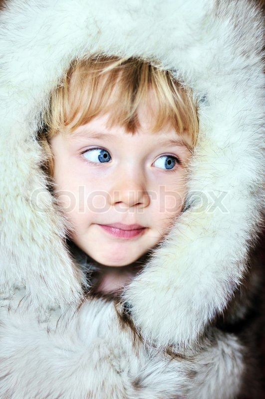 Stock image of 'Little girl in furs'
