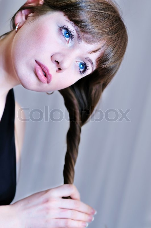 Stock image of 'Girl twisting hair'